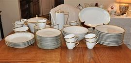 Very modern lines fine German porcelain service with gold trim on white.  There is more dessert/salad plates than are shown here.  The service is without damage or wear and serves 12.
