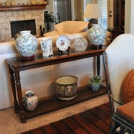 Console or sofa table matches end table in the living room.  A lovely hand painted German pitcher and reticulated shallow bowl share the space with other pieces.
