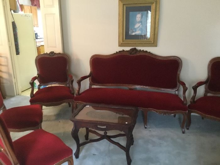 Antique upholstered settee and four chairs.
