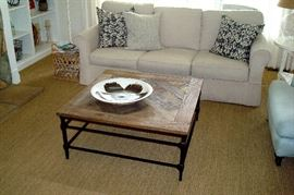 "Arhaus wrought iron and wood coffee table and Baldwin 88"" sofa like new with slip covers installed."
