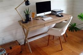 Modern desk and mid century style chair.