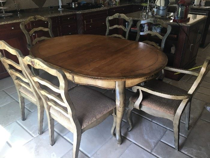 "dining table set with one inserted leaf and 6 chairs.         matching with previous side buffet cabinet and  next 2 bar stools.                                                                                                               L/160"" x W/120"" (with one leaf inserted)"
