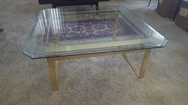 $50   Glass top table with brass base
