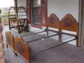 Pair walnut twin beds.