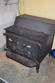Fisher Wood Stove has claw feet with it