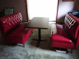 Vintage  brand new condition Diner Booth Set of slick vinyl tufted benches with table in Candy Apple Red. Reproduction online sells for $2298.16 at https://www.retroplanet.com/PROD/18728.html?gclid=CjwKCAjw8_nXBRAiEiwAXWe2ydLb-gAb7OqqAj969yzqH-dZ1tdhWwWfe8SM-02NaV76K_1sBulvwxoCxDsQAvD_BwE