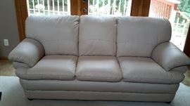 Beautiful off-white faux leather sofa in like-new condition. $150.00