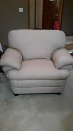 Beautiful off-white faux leather chair in like-new condition. $50.00