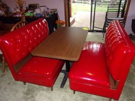 Vintage  brand new condition Diner Booth Set of slick vinyl tufted benches with table in Candy Apple Red.  Reproduction online sells for $2298.16. OUR PRICE: $500  See reproduction at https://www.retroplanet.com/PROD/18728.html?gclid=CjwKCAjw8_nXBRAiEiwAXWe2ydLb-gAb7OqqAj969yzqH-dZ1tdhWwWfe8SM-02NaV76K_1sBulvwxoCxDsQAvD_BwE
