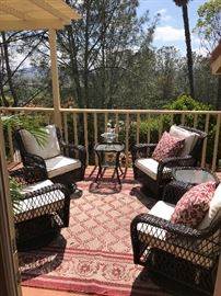 This set of 4 outdoor wicker chairs rock and swival