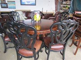 6 Stanley Dining Chairs & A beautiful 60 inch round table with a leave
