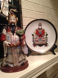 One of several Asian statues and plates