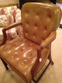 Gold/tan leather arm chair