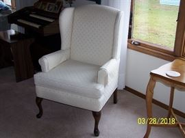 Two matching wing backed chairs in excellent condition