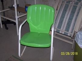 One of two matching retro metal lawn chairs.  Also have other folding lawn chairs and a hammock with stand.