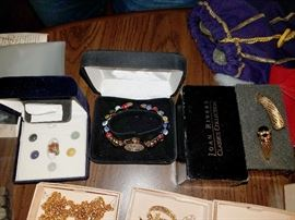 Costume jewelry. Lots of good quality treasures. Lots from QVC. Joan Rivers and more