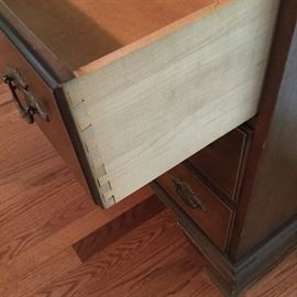 Dovetailed drawers on the secretary
