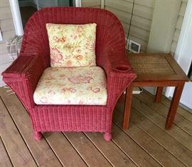 Cute red wicker chair!