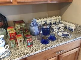 Dutch collectibles.  McCoy cookie jar.  German ceramic canister set with windmill design.  5 large canisters and 5 small spice containers makes a 10 piece beautiful set.  Old depression ware cookie jar and two jelly holders, one without lid.  Droste tins.  A few delft pieces.