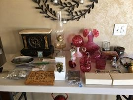 Marble top Mantel Clock from 1895.  Pieces of Cranberry glass.  Wood napkin holder in burned design.