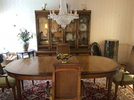 Dining room set. The table has 3 extensions and pads-table, chairs and china display cabinet.