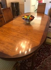 Detail of dining room table from previous photo, with three extensions and pads.