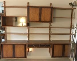 Adjustable shelving unit, approximately 8' wide, late 50s as is. $1,000