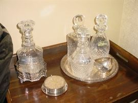 close up of liquor decanters, and all come with sterling silver ID chains