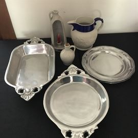 Contemporary metal ware, pottery and antique parian pitcher.