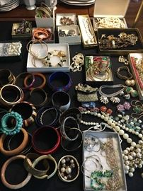 Big table full of vintage costume jewelry.