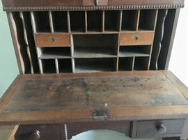 Antique walnut secretary bookcase. Purchased locally in the 1980s and believed to be a regional piece from southern Kentucky or Tennessee, circa 1850. One panel of the original glass is cracked in the upper inside corner.