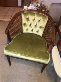 Hollywood regency cane-backed chair; one green and one gold