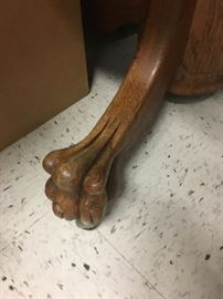 Antique pedestal claw foot table