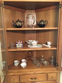 Inside of china cabinet with dishes