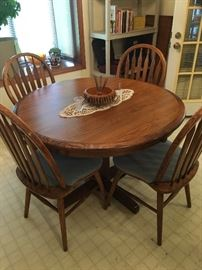 small dining table with 1 leaf and 4 matching chairs