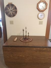 large drop-leaf dining table with 4 leaves, clocks