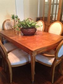 Fine looking Danish Modern dining table with 8 upholstered chairs
