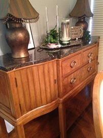 This 2-door, 3-drawer buffet has a marble top.