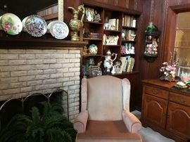 One of three pink armchairs, bar