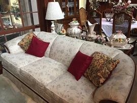 Sofa, sofa table, Capodimonte, dining table in background
