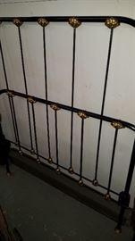 Iron rail twin bed