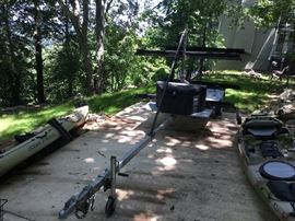 Kayak Trailer - 4 boat hauler carries 1 to 4 - 6' to 14' Kayaks. Includes tool box, plywood platform for storage with lightweight galvanized steel frame extension tongue and integrated tie down points makes traveling with your kayak(s) a lot easier.