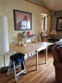 craft table, lamps, sofa, pictures