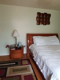 bed room set, night stand, art work, rug, lamp