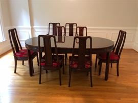 "Gorgeous Rosewood dining room table purchased in China. Measures 44"" across and 44"" long with no leaves. Photo shows table with 2 18"" leaves in. 8 chairs- 2 captain, 6 side chairs."