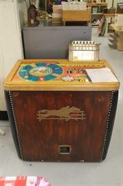 Antique horse racing machine.