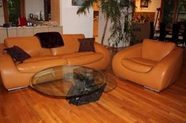 Quality Italian Leather Sofa and Side Chair with Modern Look and Round Coffee Table
