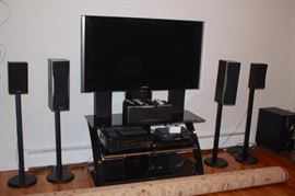Entertainment Center with Flat Screen and Speaker Set