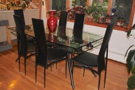Modern Glass and Metal Dining Table with Six Leather Chairs