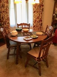 Dining table with 4 chairs and 2 leaves